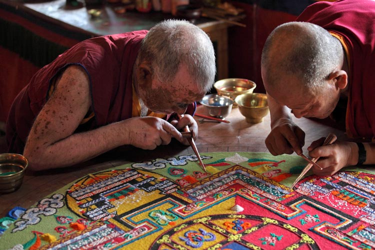 Tibetan Mandala - monks concentrating
